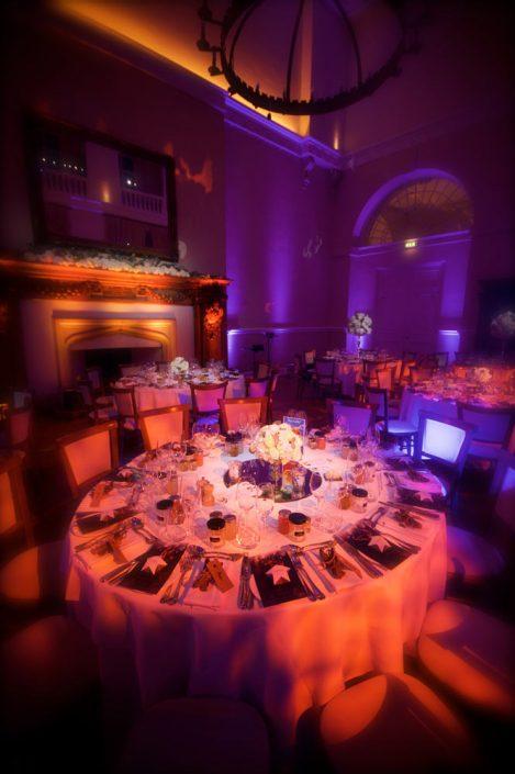 Farnham Castle barn wedding table lighting, uplighting, fairylights