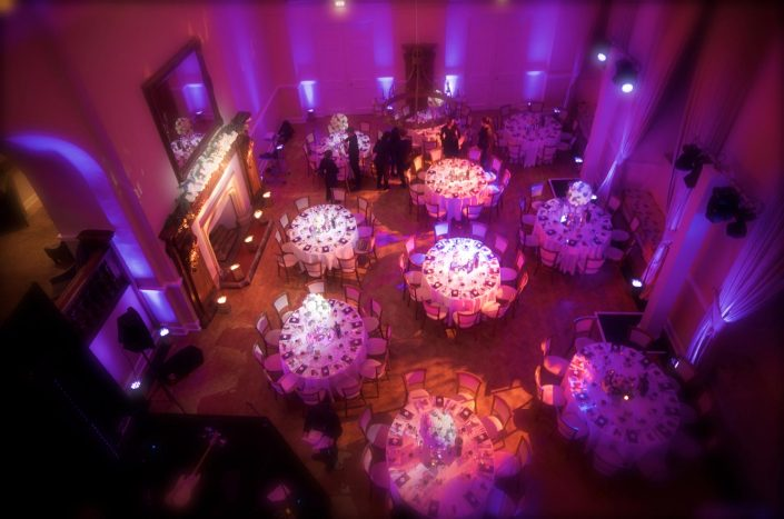 Farnham Castle barn wedding table lighting, uplighting, fairylights