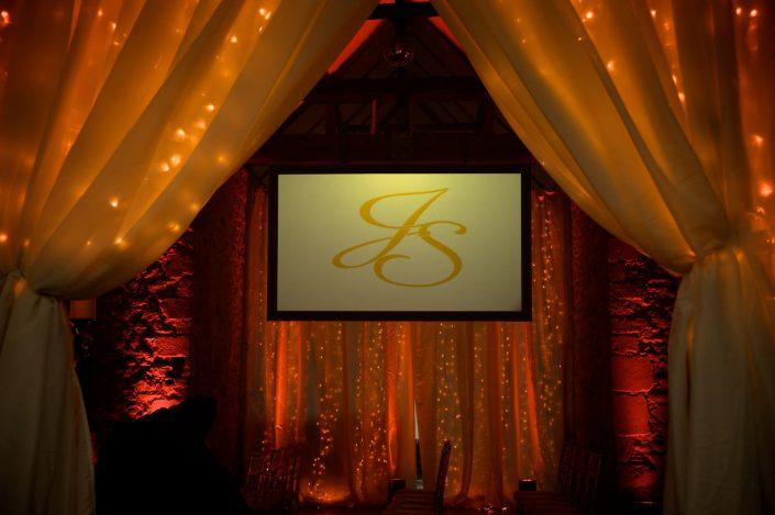 Notley Abbey wedding event lighting - uplighting, fairylight canopy, draping, chandaliers