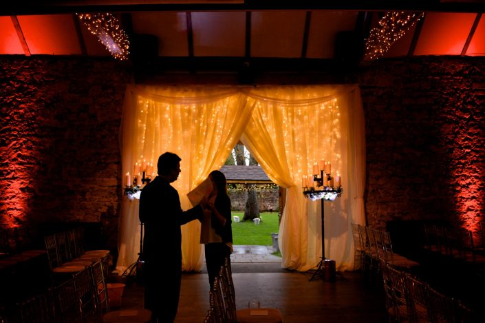 Notley Abbey wedding event lighting - uplighting, fairylight canopy, draping, chandaliers